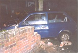 Car crashes through wall....