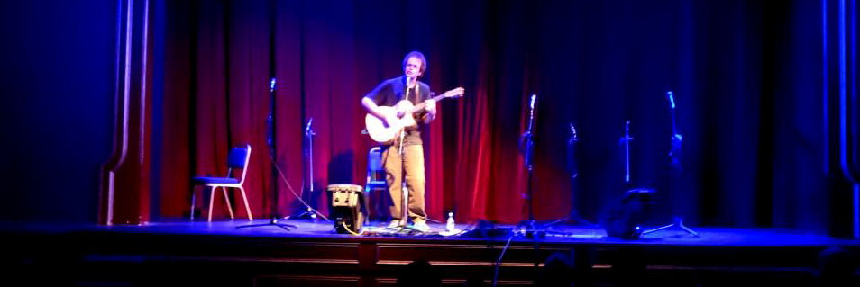Julian Mount sings on stage.
